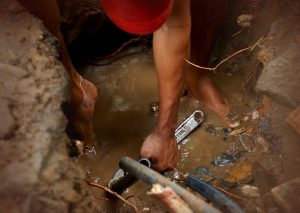 Plumber in Trench